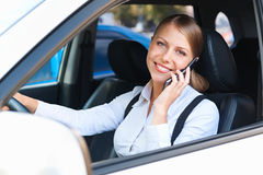 Woman driving the car and talking on the phone Stock Photo