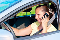 Woman driving a car talking on the phone Royalty Free Stock Photos
