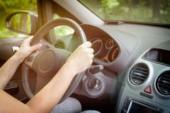 Woman driving a car, view from behind Royalty Free Stock Photo