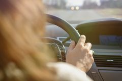 Woman driving a car, view from behind Royalty Free Stock Photography