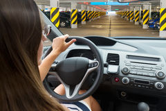 Woman driving a car. View inside out royalty free stock photography