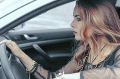 Woman is driving a car royalty free stock image