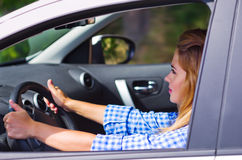 Woman is driving car Stock Photos