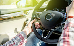 Woman driving changing ruise control setting Royalty Free Stock Photography