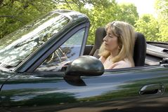 Woman Driving in Convertible. Blond woman driving in a green convertible in the hills Stock Images