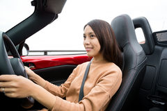 Woman driving convertible car Royalty Free Stock Image