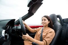 Woman driving convertible car Stock Photo