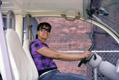 Woman Driving Electric Car. African-Native American woman drives electric vehicle in maintenance of Brooklyn Bridge Park, NYC royalty free stock images