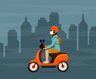 Woman driving electric scooter in city smog wearing protection mask Royalty Free Stock Image