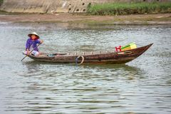 Woman driving the fishing boat, Vietnam Royalty Free Stock Photo