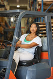 Woman Driving Fork Lift Truck In Warehouse Stock Images