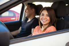 Woman driving with a friend Royalty Free Stock Images