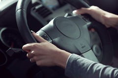 Woman driving hands close-up Royalty Free Stock Image