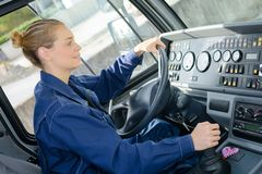 Woman driving heavy goods vehicle. Heavy royalty free stock image