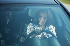 Woman is driving her car Royalty Free Stock Photos