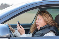Woman is driving her car Stock Image