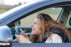 Woman is driving her car royalty free stock image
