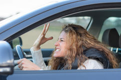 Woman is driving her car Stock Photos