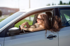 Woman driving her car Stock Images