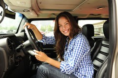 Woman driving her new bulletproof truck Royalty Free Stock Image