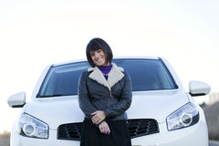 Woman driving her new car Stock Photos