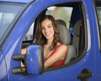 Woman driving her new car Stock Image