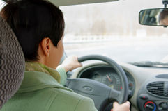 Woman is driving on highway Stock Images