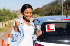 Woman driving license. Cheerful black woman showing a driving license she just got Stock Photos