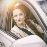 Woman driving and looking away Stock Images