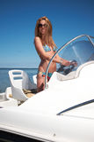 Woman driving a motor boat Stock Photos