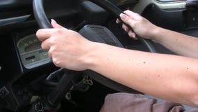 Woman Driving an Old Car Stock Photos