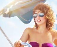 Woman driving sailboat Royalty Free Stock Photos