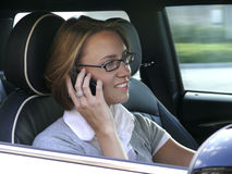 Woman in the driving seat Stock Photography