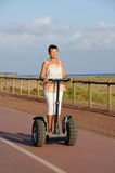 Woman driving segway Stock Image