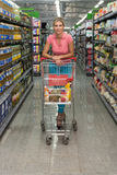 Woman Driving Shopping Cart While Grocery in Supermarket Stock Photos