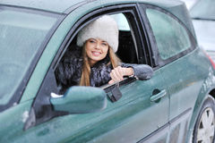 Woman driving showing car keys out the window Royalty Free Stock Photography