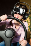 Woman with a driving simulator Stock Photo