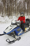 Woman driving a snowmobile in Ruka of Lapland Stock Image