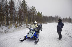 Woman driving snowmobile in Ruka in Lapland Stock Photos