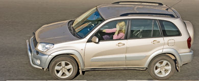 Woman driving some luxury suv of my Royalty Free Stock Image