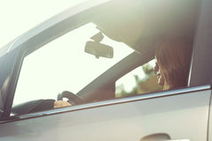 Woman driving in a sunny day Stock Image