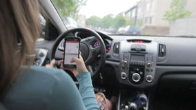 Woman driving while texting. 1080p