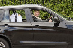 Woman driving to work Stock Photo
