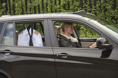 Woman driving to work Royalty Free Stock Images