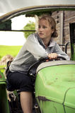Woman driving a tractor Stock Photo