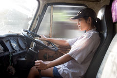 Woman driving a truck Royalty Free Stock Photos