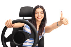 Woman driving a vehicle and giving thumb up Royalty Free Stock Images