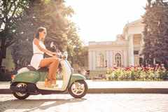 Woman driving vintage scooter Royalty Free Stock Photography