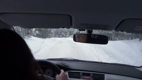 Woman Driving Car On Crossroad And Snowy Road At Winter Day