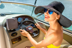 Woman driving yacht Royalty Free Stock Photo